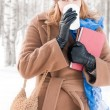 Young woman with books in winter — Stock Photo