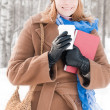 Young woman with books in winter — Foto Stock