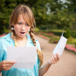 Beautiful young student girl with letter — Stock Photo