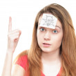 Girl with light bulb on paper on her forehead. — Stock Photo #11436568