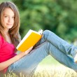 Happy young student girl with book — Photo
