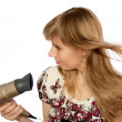 Girl with hairdryer - Stock Photo