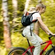 Young woman with bicycle in forest — Foto de Stock