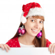 Santa girl holding empty board — Stock Photo