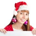 Santa girl holding empty board — Stock Photo
