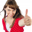 Beautiful woman making gesture thumbs up — Stock Photo
