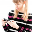 Young girl playing video game — Stock Photo