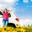 Womand her car in field — Stock fotografie #11438434