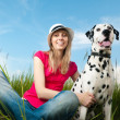 Stock Photo: Young woman with her dog pet