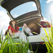Young womresting in car — Stock Photo #11438459
