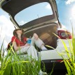 Foto Stock: Young womresting in car