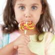 Little girl eating lollipop — Stock Photo