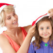 Mother and daughter together in christmas hats — Stock Photo