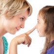 Finger of mother on nose of daughter — Stock Photo