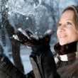 Girl throwing snow — Stock Photo