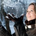Girl throwing snow — Stock Photo