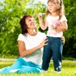 Happy mother with her daughter — Stock Photo #11438811