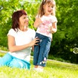 Happy mother with her daughter — Stock Photo #11438813