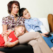 A family watching  a tv — Stockfoto