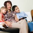 A family watching a tv — Stock Photo #11438820