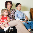 A family watching a tv — Stock Photo #11438826