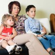A family watching a tv — Stock Photo