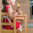 Stock Photo: A little girl at a table