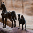 Horse and camel figurine — Stock Photo
