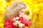 Beautiful little girl with teddy bear — Stock Photo