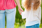 Mother and daughter hand in hand — Stock Photo