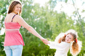 Young mother walking with her daughter — Stock Photo
