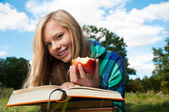 Student girl with apple and books — Stock Photo