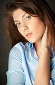 Beautiful young woman on dark background — Stock Photo