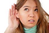 Teenage girl listening — Stock Photo