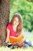Happy student girl reading book — Stock Photo
