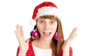 Surprised woman in santa hat — Stock Photo