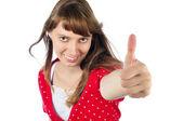 Beautiful woman making gesture thumbs up — Stock Photo