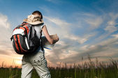Young woman with map and backpack — Stock Photo