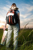 Young woman with map and backpack — Foto de Stock