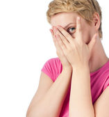 Young woman spying with her eye — Stock Photo