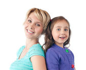 Happy mother and daughter smiling in studio — Stock Photo