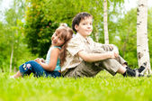 Little brother and sister sittin back to back — Stock Photo