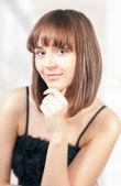 Beautiful young woman thinking — Stock Photo