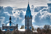 Beautiful church with cloudy sky in background — Stock Photo