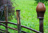 Pot on fence — Stock Photo