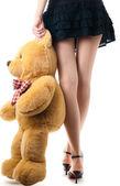 Sexig tjej med leksak björn — Stockfoto