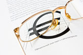 Glasses on the book page — Stock Photo
