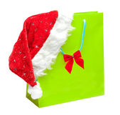 Green packet with santa hat — Stock Photo