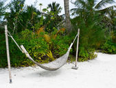 Hammock on the tropical beach — Stock Photo