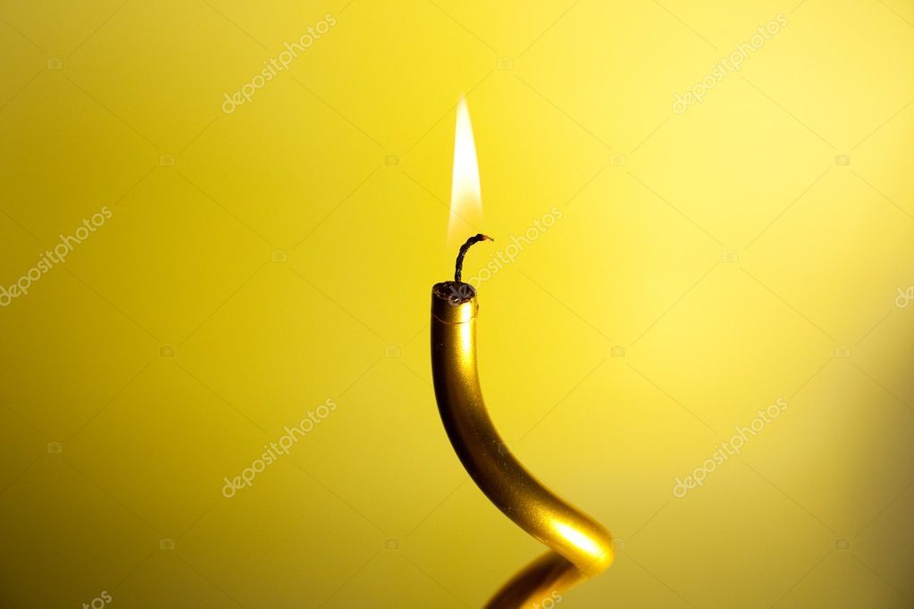 Burning candle on colourful vivid background — Stock Photo #11439125